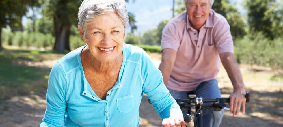 couple enjoys riding bikes together outside
